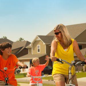 Mother and children biking